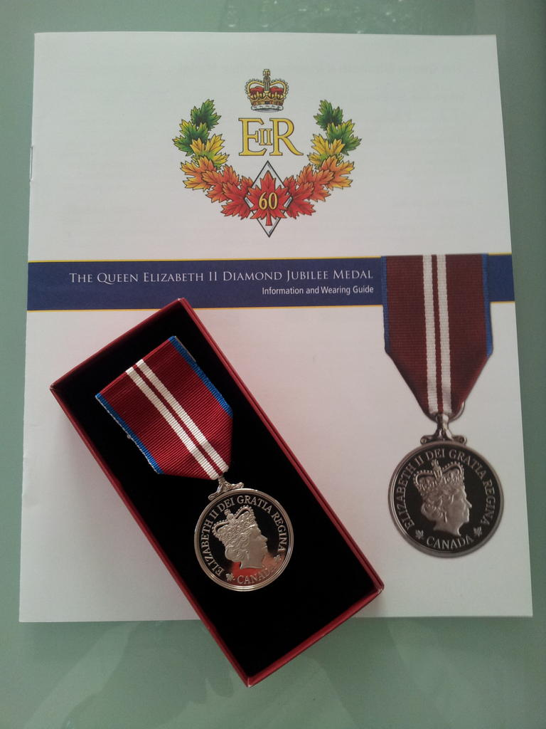 Paul is presented with the Queens Diamond Jubilee Medal for his work with Designated Driver Dads